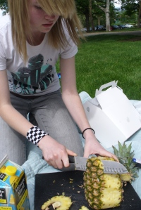 Maddy Cutting a Pineapple